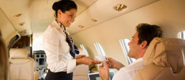 Flight-attendant-serving-drink