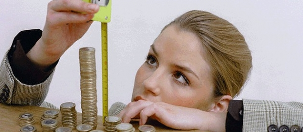 woman-with-stacks-of-coins