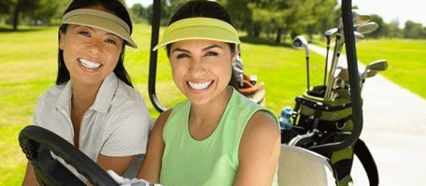 two women in golf carts