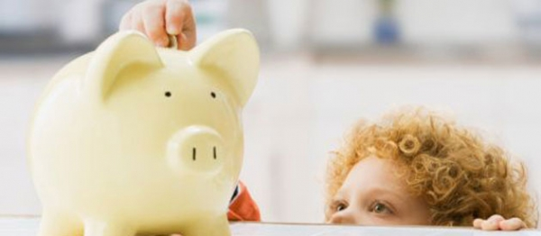 small-child-with-piggy-bank